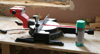 Fixing up the mitre saw with lubricant
