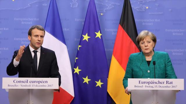 Macron y Merkel abogan por la vía del diálogo en Ucrania 