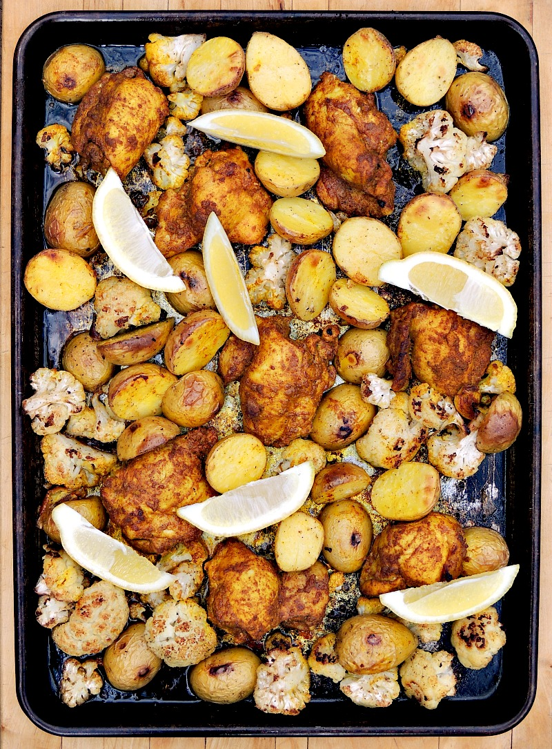 Sheet Pan Chicken Shawarma on a sheet pan with lemon wedges