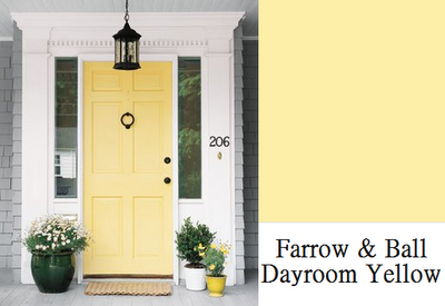 Soft Yellow House With Shutters