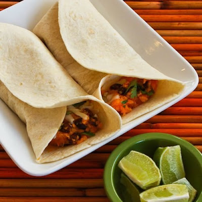 Slow Cooker Recipe for Sweet Potato and Black Bean Burritos with Lime from Kalyn's Kitchen found on SlowCookerFromScratch.com