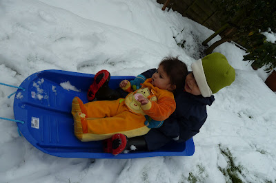 Snow day with children in the garden