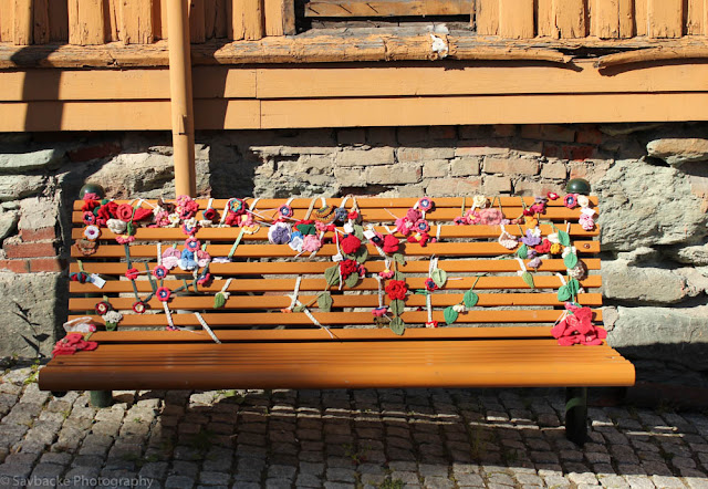 Crochet graffiti covered bench