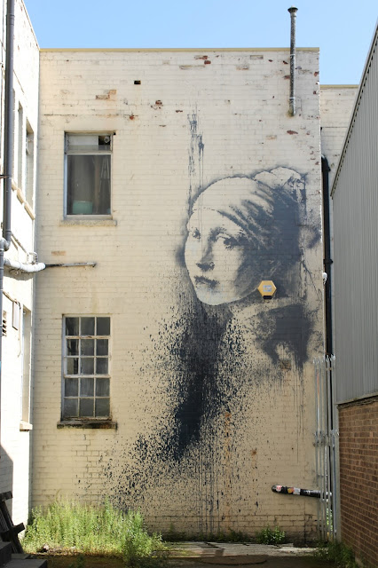 Banksy Girl with a Pierced Eardrum Bristol street art Hanover Place Harbourside