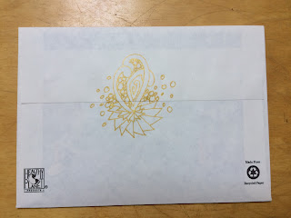 gold ink doodle on the back of an envelope