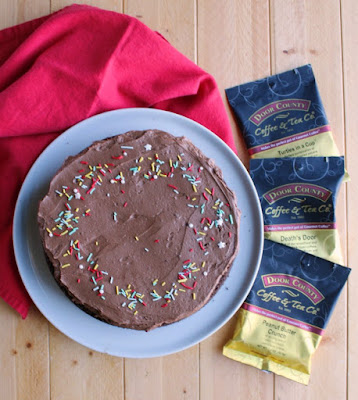 whole frosted chocolate mayo cake with packages of door county coffee