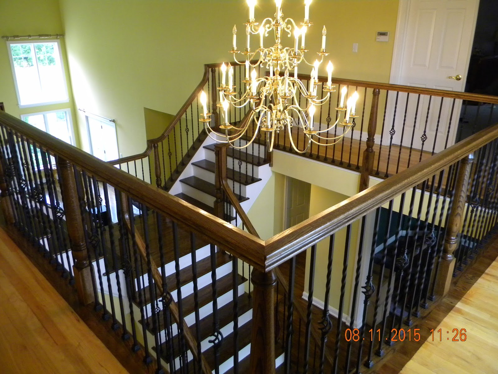 Wood Stairs and Rails and Iron Balusters: Install Iron