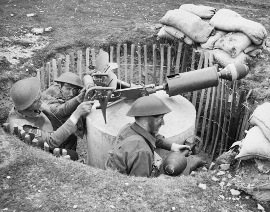 Photograph of Home Guard soldiers operating a 'Blacker Bombard' spigot mortar during training at No. 3 GHQ Home Guard School at Onibury near Craven Arms in Shropshire, 20 May 1943. H30181