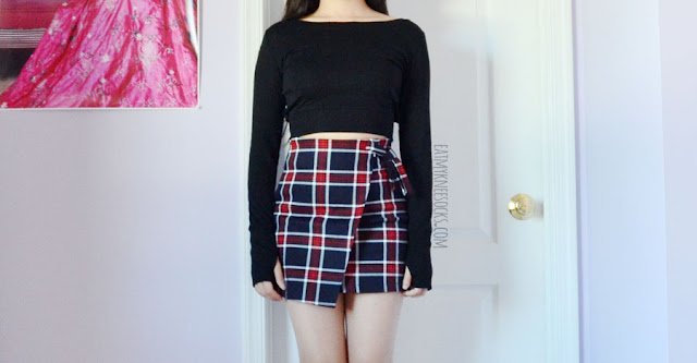 Black long sleeve cutout back boat neck crop top with thumbholes from SheIn + red navy asymmetric plaid bodycon skirt.