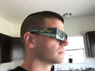 side view eclipse glasses over regular glasses