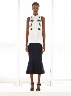 2017 Cruise Collection Jonathan Simkhai white sleeveless top with lacing and cutout details and black knit skirt
