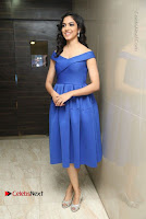 Actress Ritu Varma Pos in Blue Short Dress at Keshava Telugu Movie Audio Launch .COM 0052.jpg