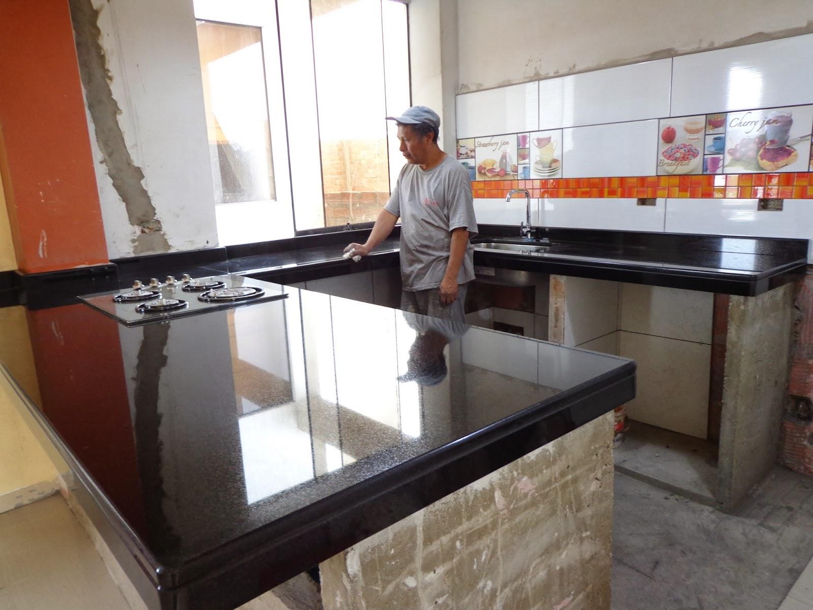 Mesas cocina granito conservaci n mantenimiento for Modelos de mesones de cocina fotos