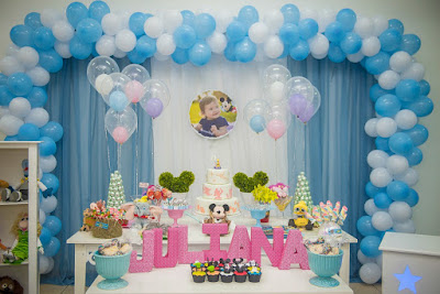 Celebrate a first birthday with a fun Disney parks birthday party.  With elements of all your favorite Disneyland and Disneyworld features, this party is bright, beautiful, and full of fun.