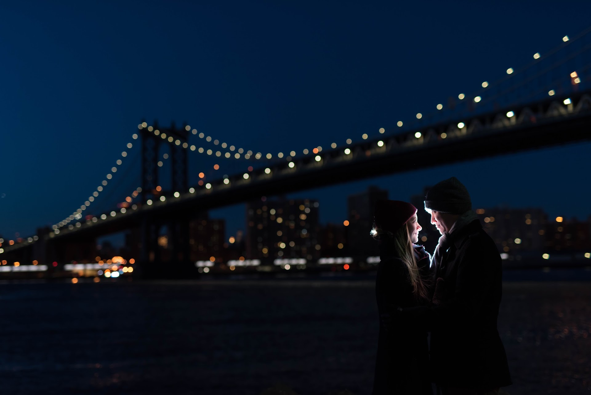 photography, engagements, couple, photography shoot, popular photo spots in nyc, brooklyn, new york, dumbo, manhattan bridge, brooklyn bridge, night, lights, nighttime, flash,