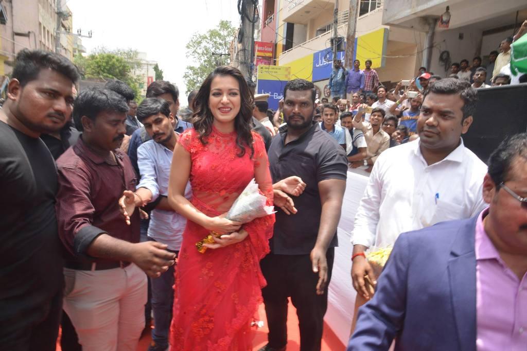 Catherine Tresa in transparent saree with Srimukhi at a mobile store launch in Guntur