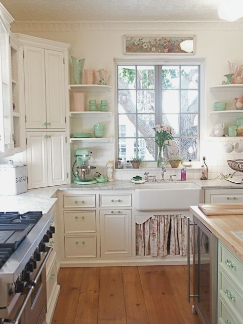 This kitchen design uses the open shelving to add pops of colorful dishes