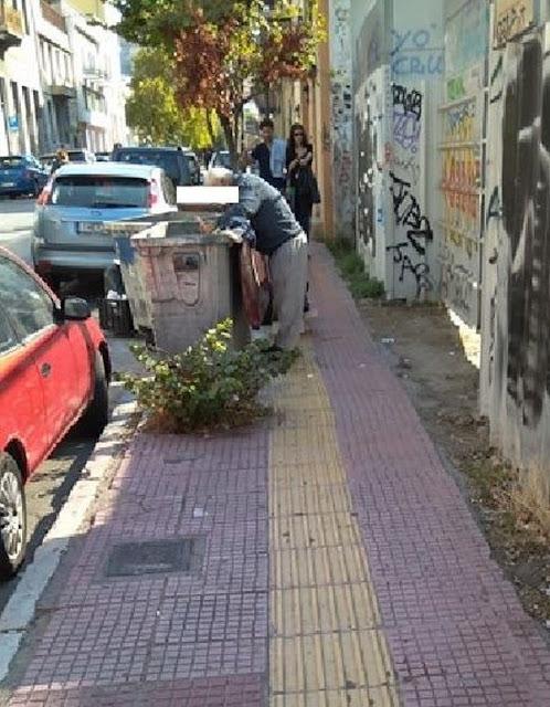 ΦΩΤΟ αφιερωμένη σε Κουντουρά – Πολίτης ψάχνει το φαγητό σε κάδο σκουπιδιών!