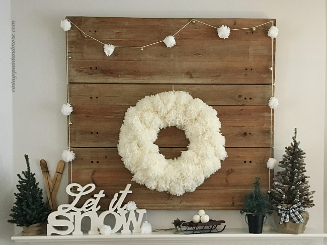 Vintage Paint and more... a winter mantel done with a diy yarn pom-pom wreath and garland and rustic winter snow decor