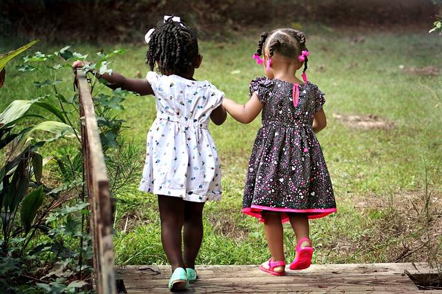 Two Girls Walking Hand-in-Hand: FRIENDS