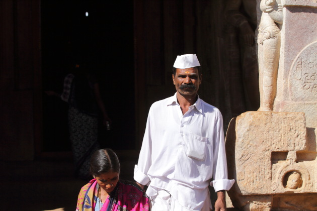 Devotee walks out of Virupaksha temple at Pattadakkal, Karnataka