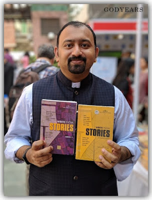 author holding two Indian books