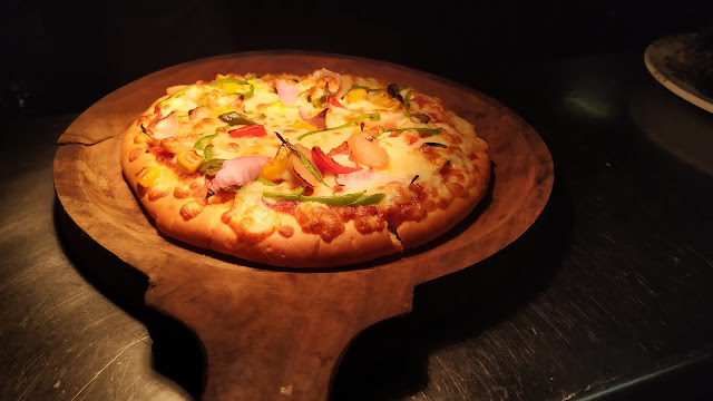 Pizza serving in a wooden spoon pizza Recipe