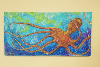 orange octopus swimming