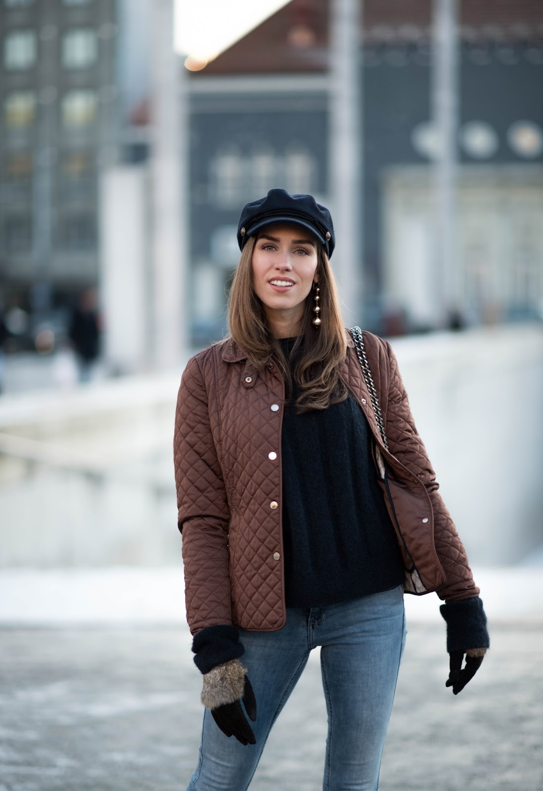 quilted jacket fisherman cap outfit