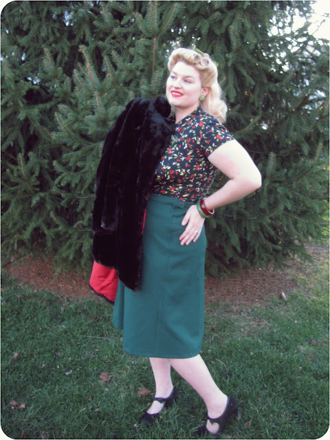 1940s plus size winter fashion with bakelite bracelets, novelty print blouse and betty grable style victory rolls