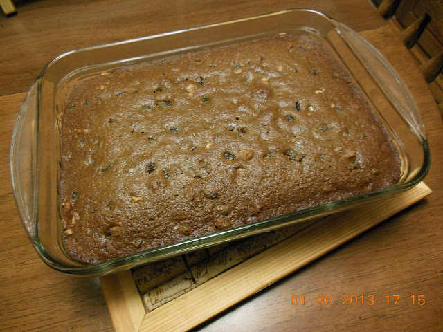Bourbon soaked raisins and walnuts in a delicious snack cake, Raisin Walnut Snack Cake.