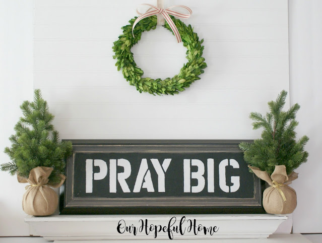 two mini spruce trees Pray Big DIY painted sign