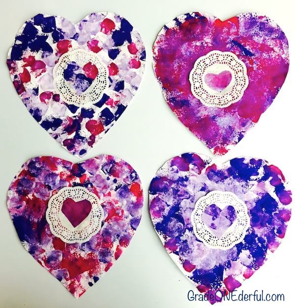 Sponge painted and doily valentine art by Grade 1 students