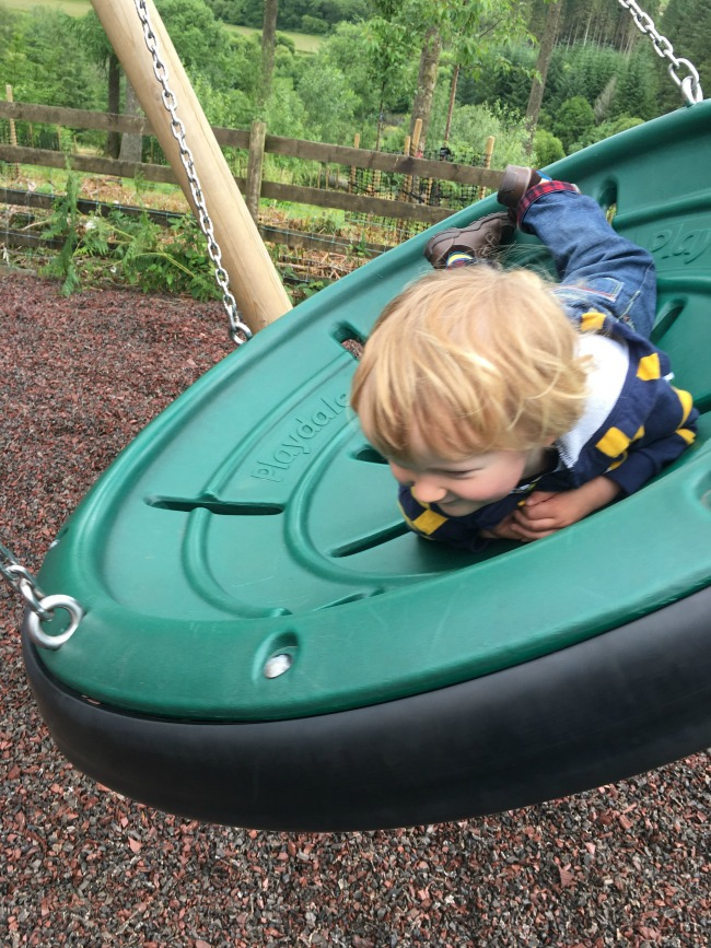 Garwnant-Visitor-Centre-A-Toddler-Explores-toddler-on-big-swing