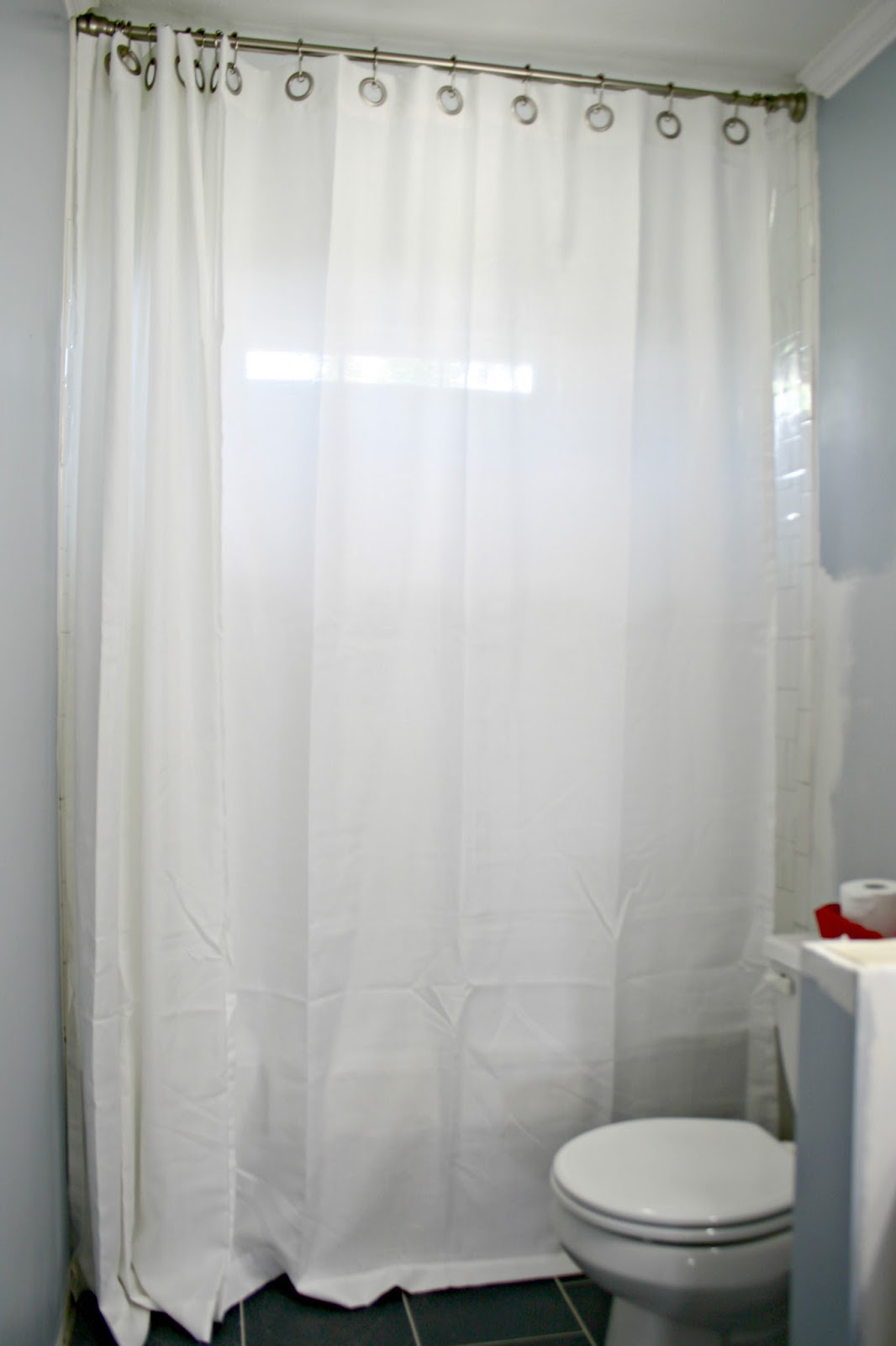 how to hang double shower curtains for