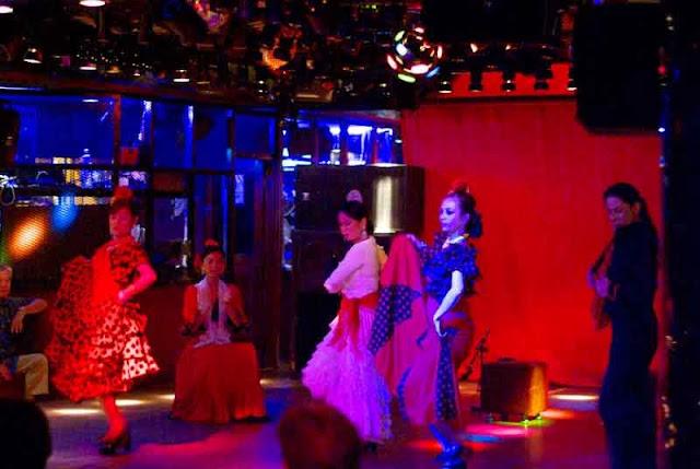 Flamenco dancers dancing on stage