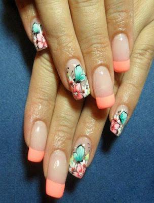 decoracion de uñas naranja con mariposas y flores facil