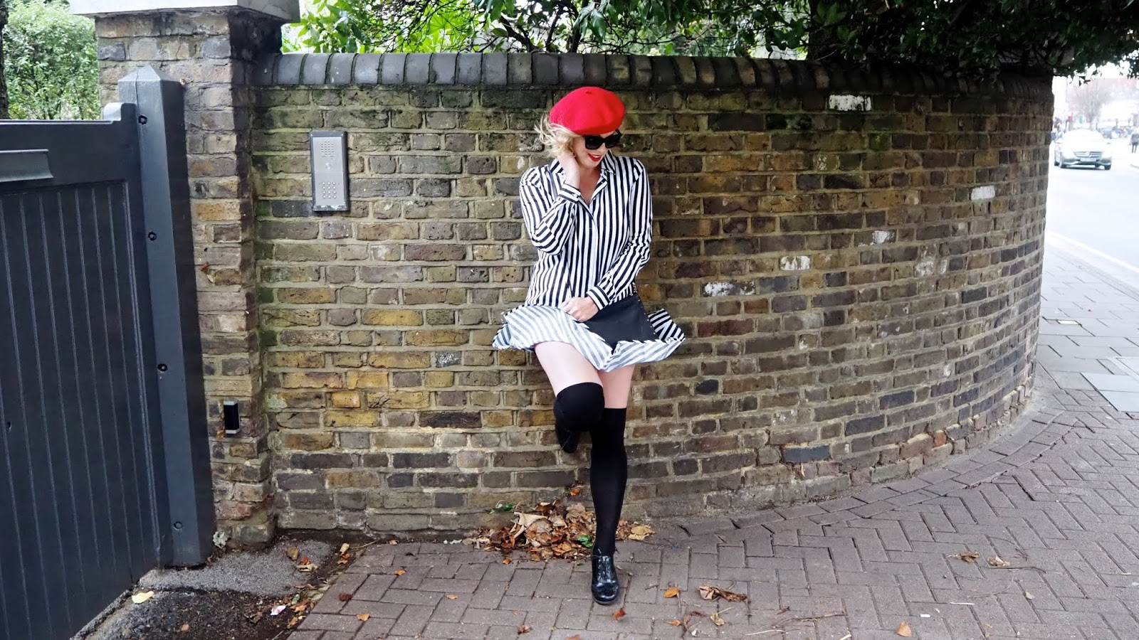 black and white striped shirt dress with flouncy hem, red beret, black over the knee socks, black brogues and red lipstick