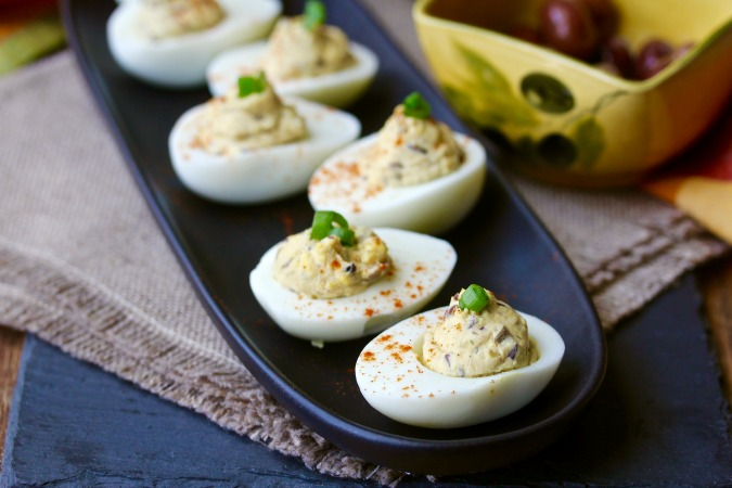 Olive Tapenade Deviled Eggs with paprika