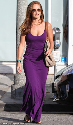 Minka Kelly in a low cut purple jersey dress