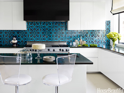 This chic blue and black patterned back splash adds a retro element to the kitchen.
