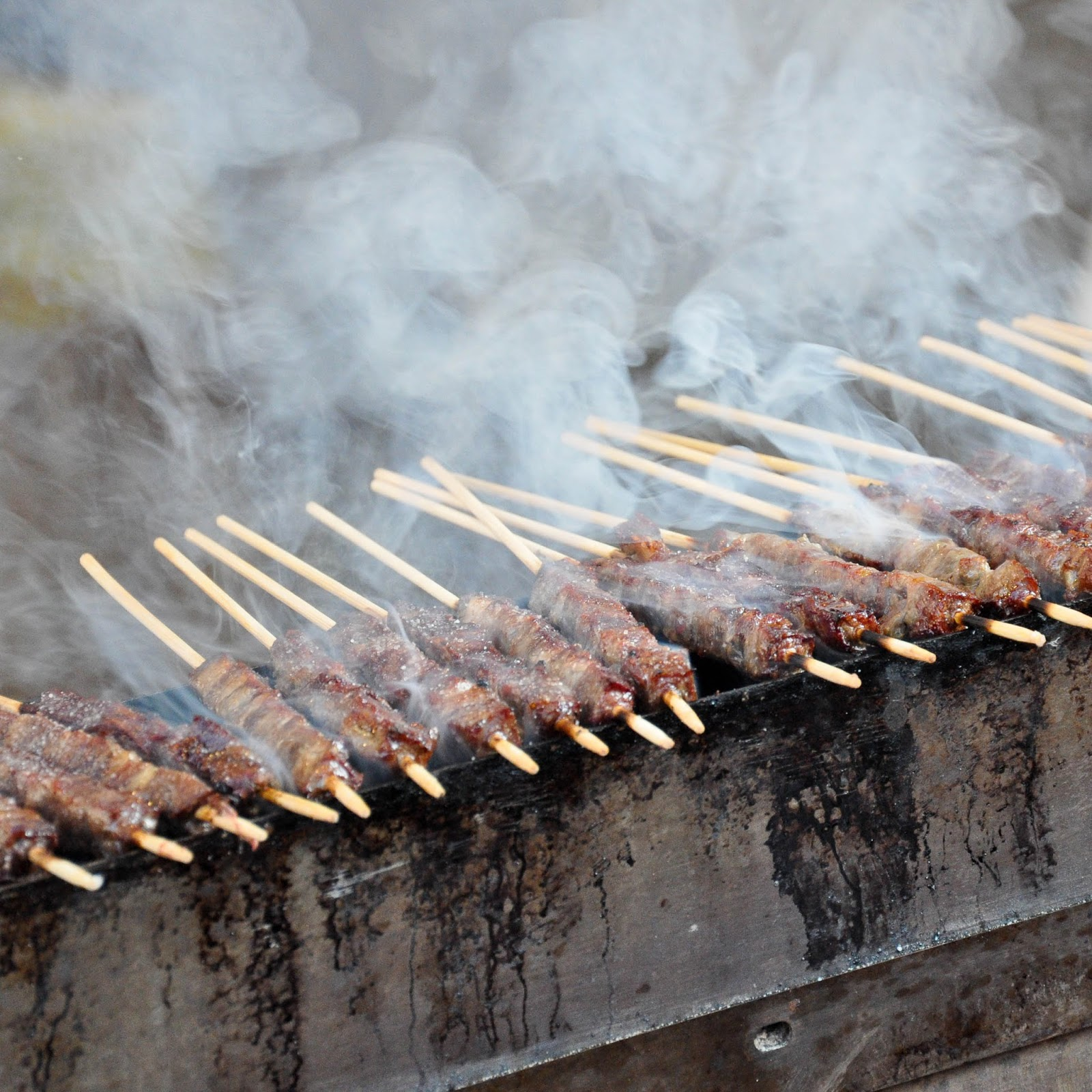Arrosticini Thienesi roasted on coals, Thiene, Veneto, Italy