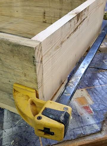 clamps help secure the pallet wood to make the box
