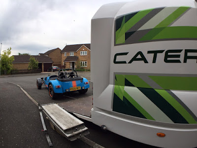 The R500 being winched into the Caterham car transporter