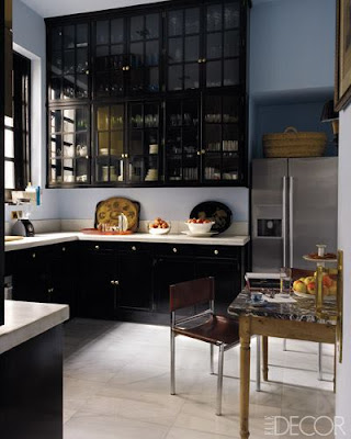 kitchens with black cabinets and white counter tops