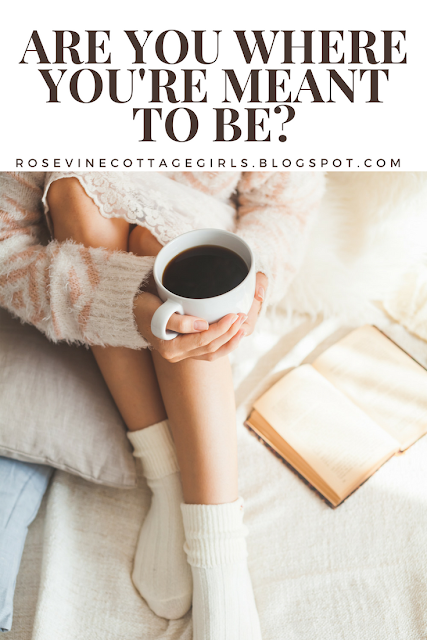 Are you where you're meant to be ? Picture of a woman on a bed with her bible holding a mug of coffee reading.