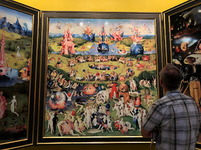 Studying The Garden of Earthly Delights up close.