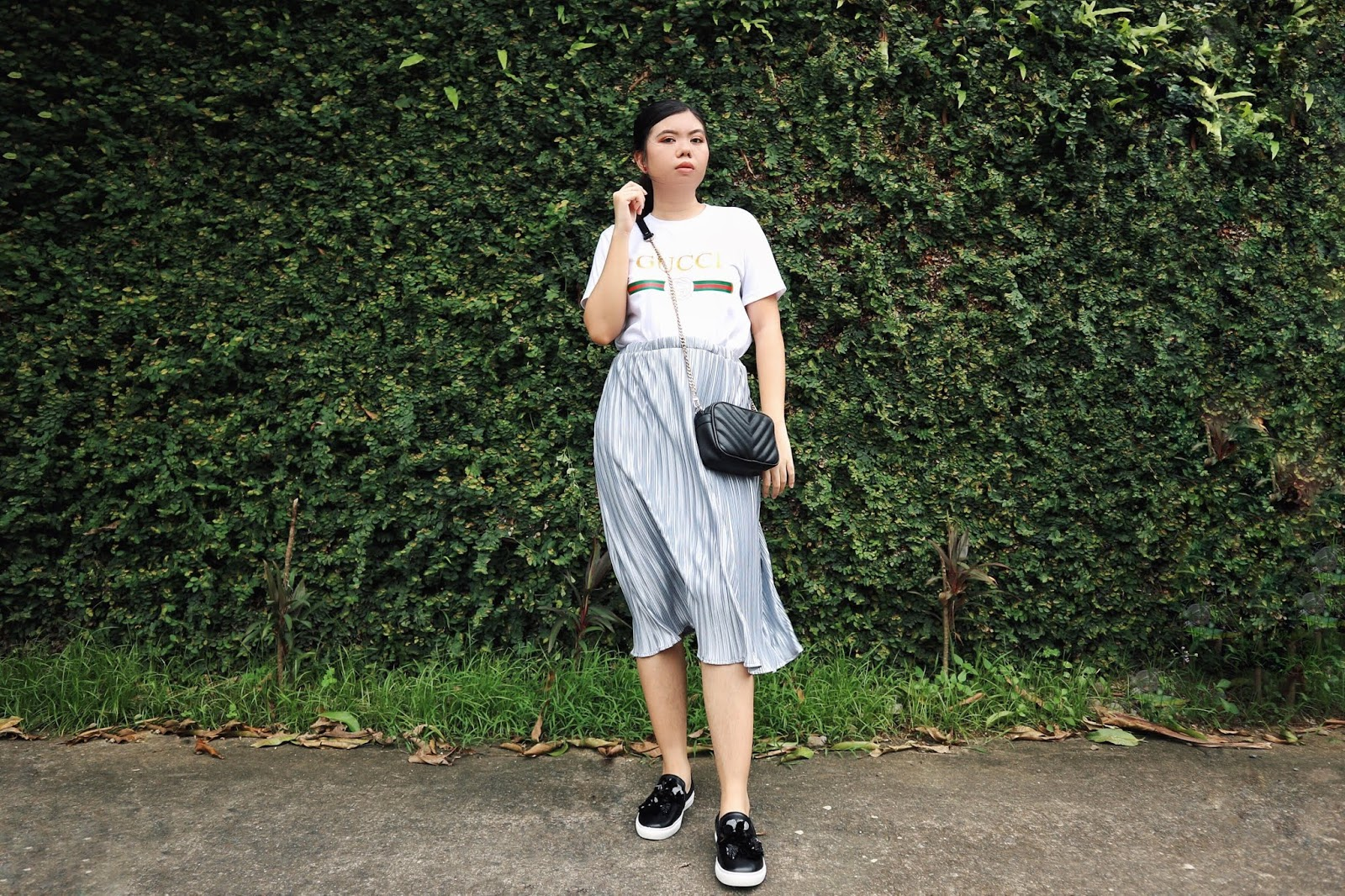 OOTD by ayacheei ft. Graphic Logo Shirt, Sling Bag, Mettalic Pleated Long Skirt, Slip on Sneakers and Rose Earrings