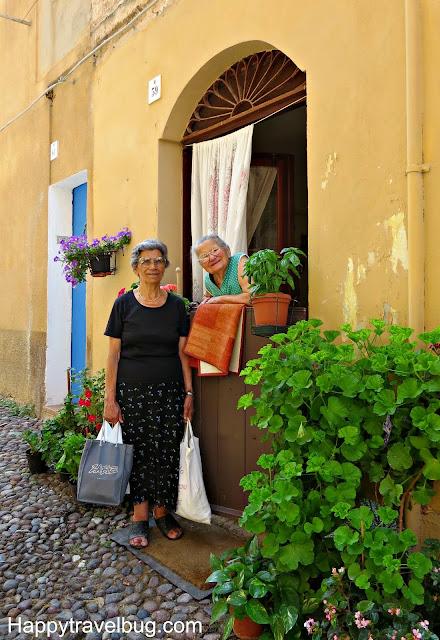 Local women of Alghero, Sardinia, Italy