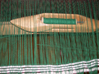 Tucking in the weft ends.